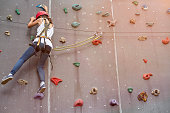 teenage girl in a free climbing wall