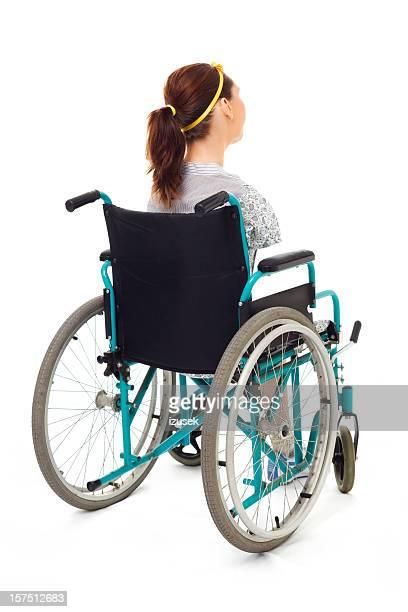 Teenage Girl In A Wheelchair, Rear View
