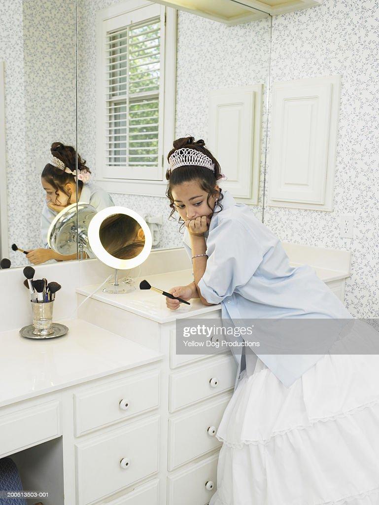Teenage girl in bathroom wearing dress and tiara stock for Bathroom dress