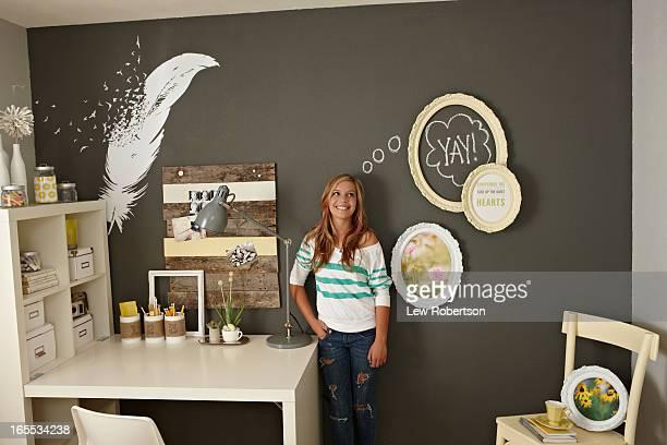Teenage girl in bedroom