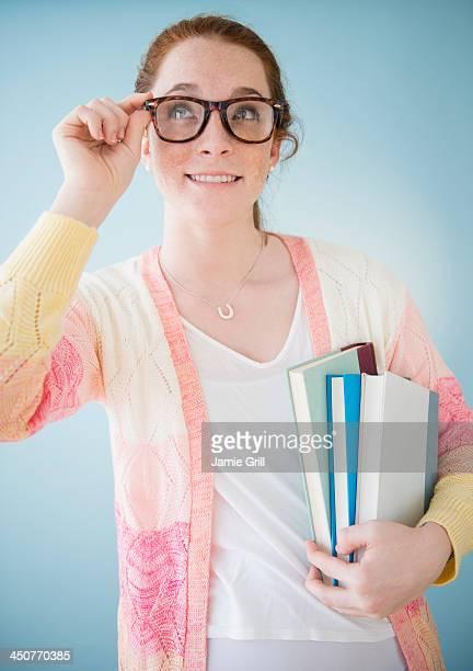 Teenage girl (14-15) in nerd glasses, studio shot