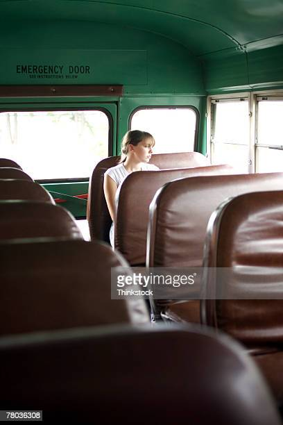 Teenage girl in school bus