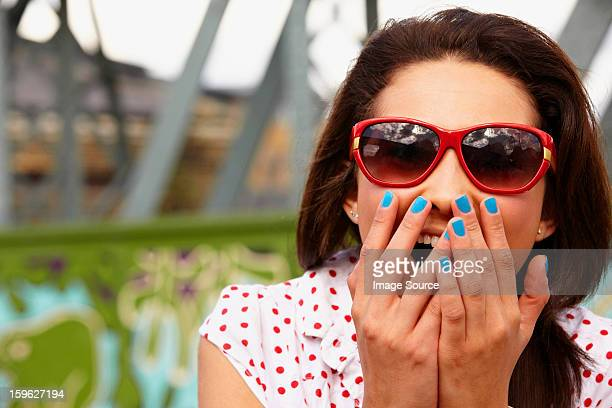 Teenage girl in sunglasses, looking shocked