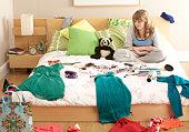Teenage Girl In Untidy Bedroom