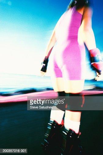 Teenage girl (15-17) in-line skating, rear view (infrared) : Foto stock