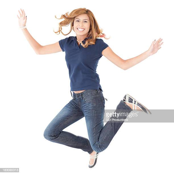 Teenage Girl Jumping in the Air, Isolated on white