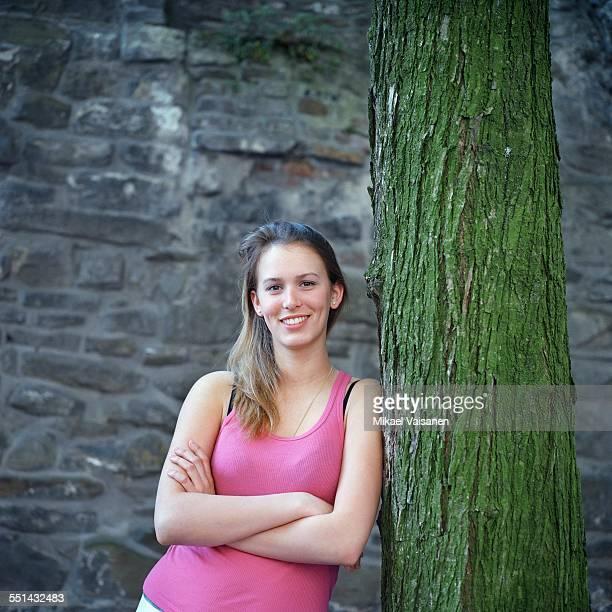 Teenage Girl Leaning on Tree