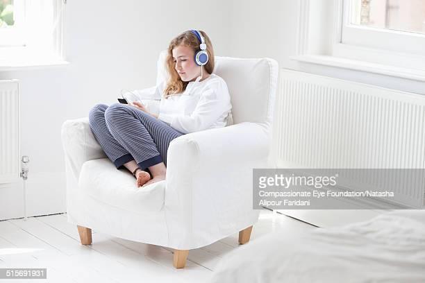 Teenage girl listening to music on smartphone