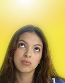 Teenage girl (15-17) looking up, close-up (Digital Enhancement)
