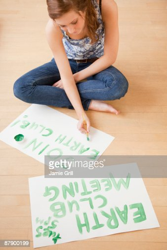 Teenage girl making signs for earth club : Stock Photo