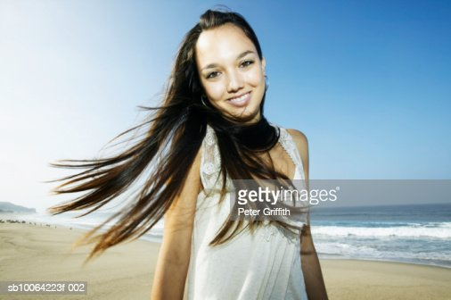 Teenage girl (16-17) on beach, portrait : Stock Photo