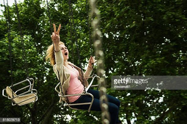 Teenage girl on chairoplane at fun fair