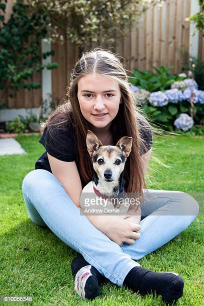 Teenage girl on the lawn with her dog