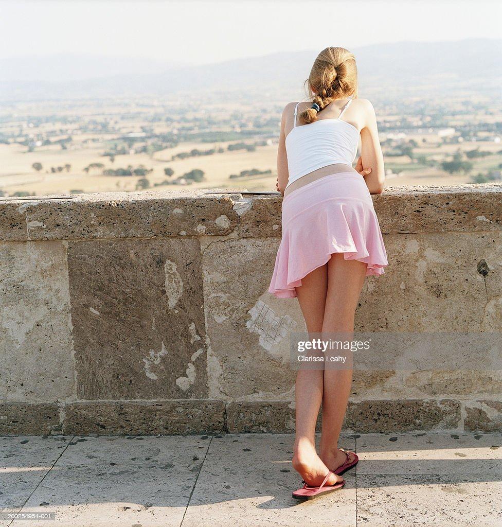 Teenage Girl Overlooking Rural Landscape Rear View Stock