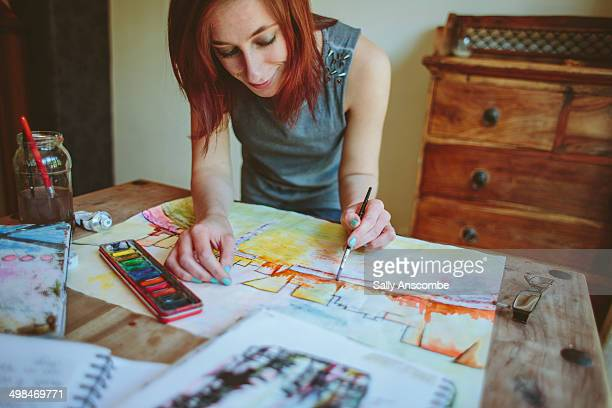 Teenage girl painting a picture