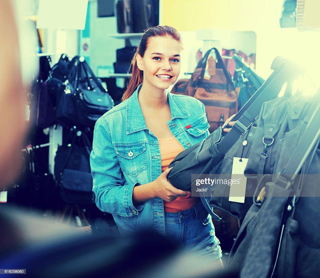 teenage girl picking  handbag : Stock Photo
