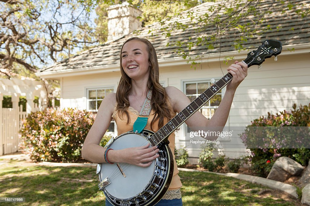 Teenage girl playing banjo