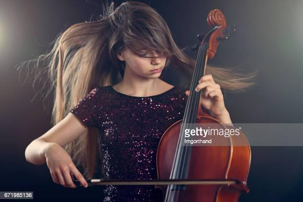 Teenage girl playing cello performance