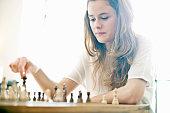 Teenage girl playing chess