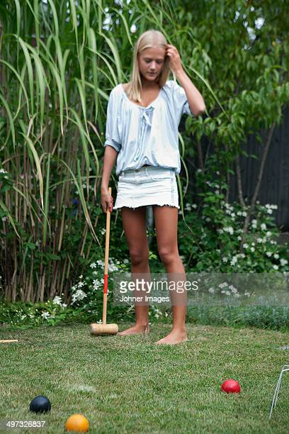 Teenage girl playing croquet, Sweden