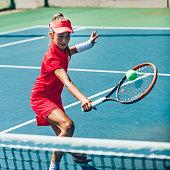 Teenage girl playing tennis. Toned image