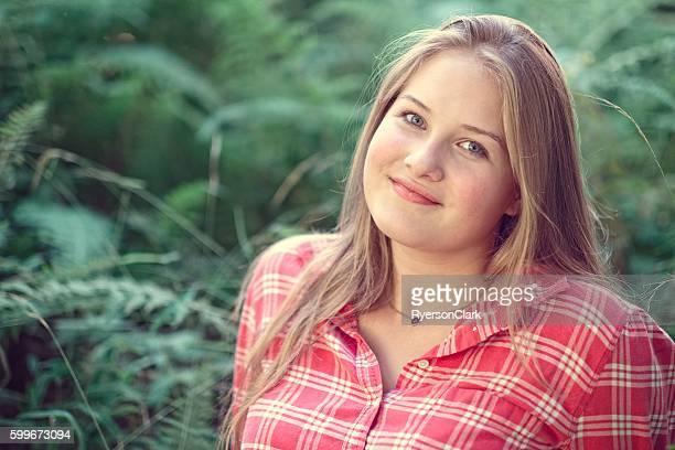 Teenage girl portrait in the forest.