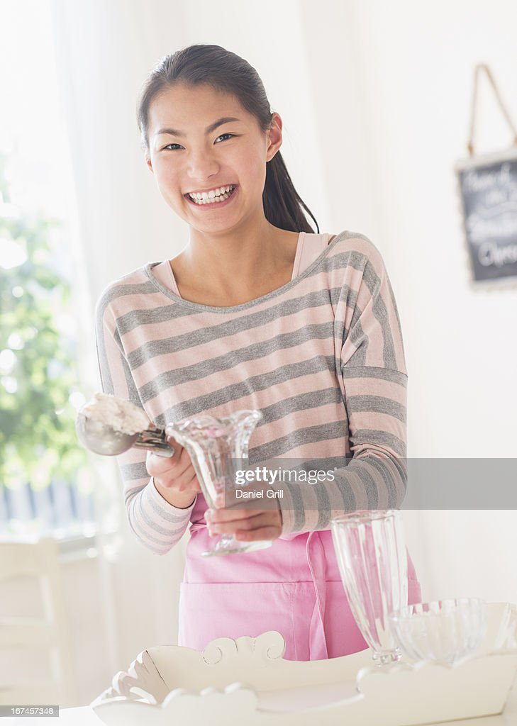 Teenage girl preparing tableware : Stock Photo