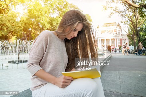 Teenage girl reading a book : Stock Photo
