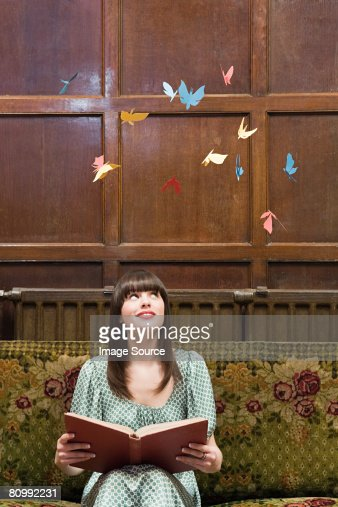 A teenage girl reading a book : Stock Photo