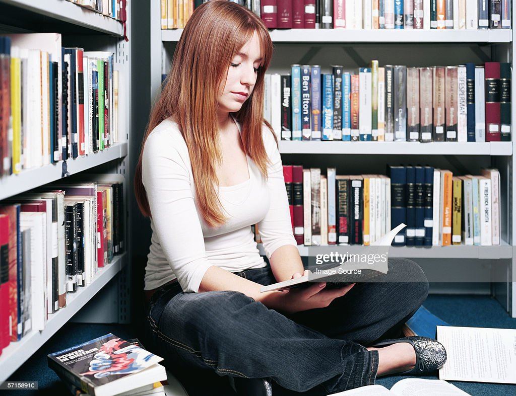 Teenage girl reading in the library