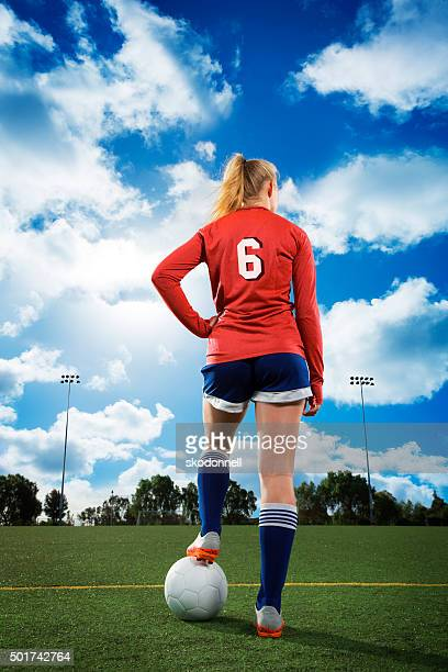 Teenage Girl Rear View with Soccer Ball
