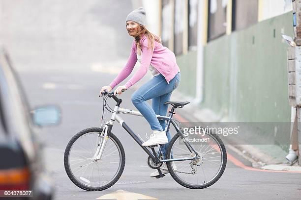 Teenage girl riding bicycle