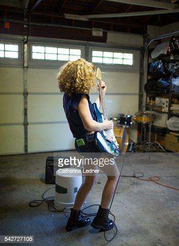 Teenage girl Rocking It in the Garage