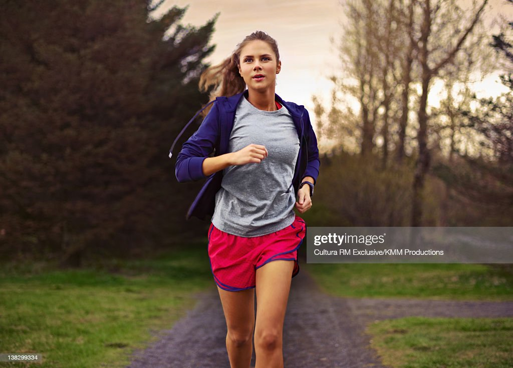 Teenage girl running in park : Stock Photo
