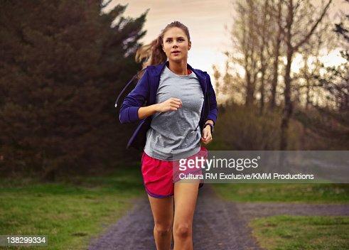 Teenage girl running in park : Stock Photo