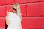 teenage girl showing middle finger gesture. Rebel and crazy teen hipster in white t-shirt showing rude sign