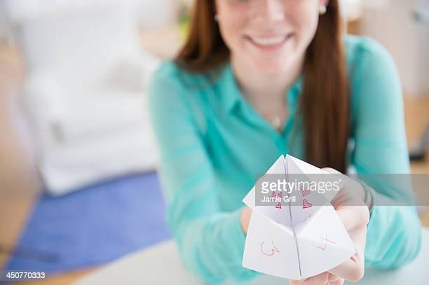 Teenage girl (14-15) showing origami