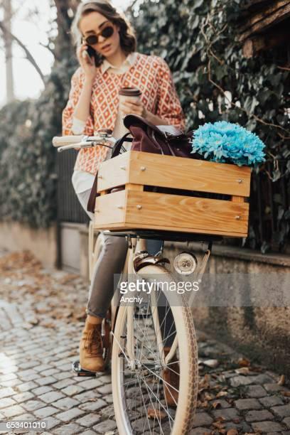 Teenage girl sitting on bike