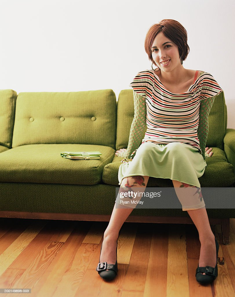 teenage girl sitting on couch portrait stock photo getty. Black Bedroom Furniture Sets. Home Design Ideas