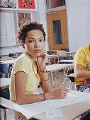 Teenage girl (15-17) sitting test in classroom portrait