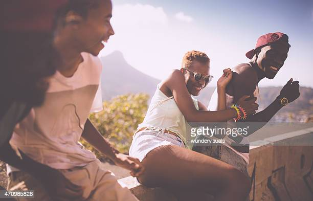 Teenage girl skater laughing and joking with friends