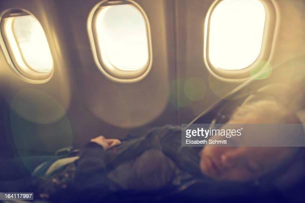 Teenage girl sleeping in businessclass seat