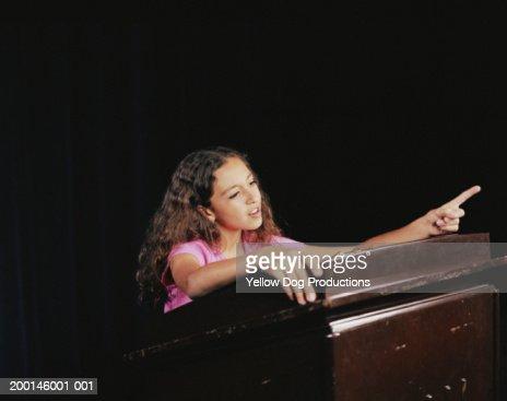 Teenage girl (12-14) speaking at podium