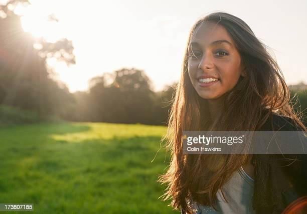 Teenage girl standing in field
