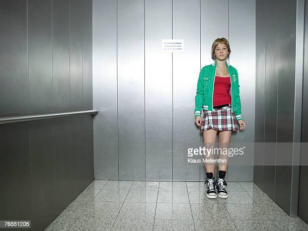 Teenage girl (16-17) standing in lift