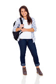 beautiful teenage girl with backpack standing on white background