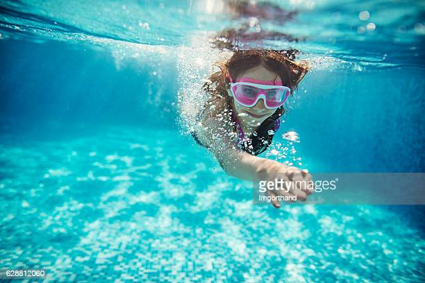 Teenage girl swimming crawl