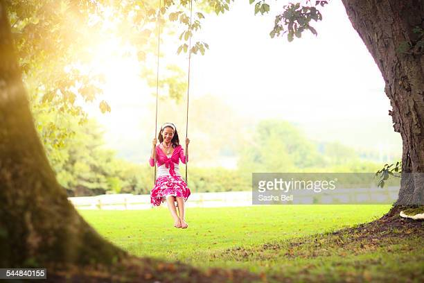Teenage Girl Swinging in the Sunshine