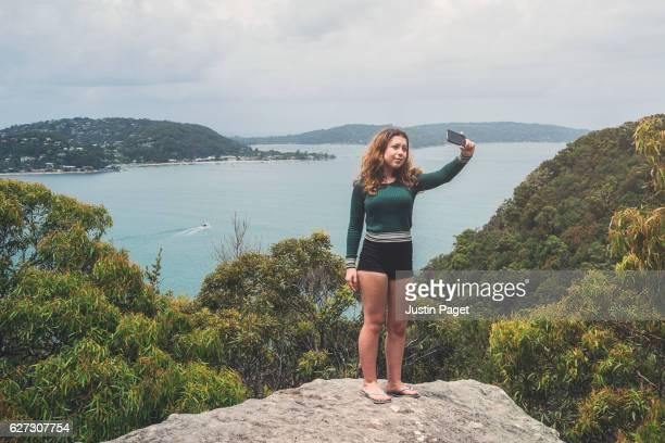 Teenage Girl taking photo in Ku-ring-gai National Park, Sydney
