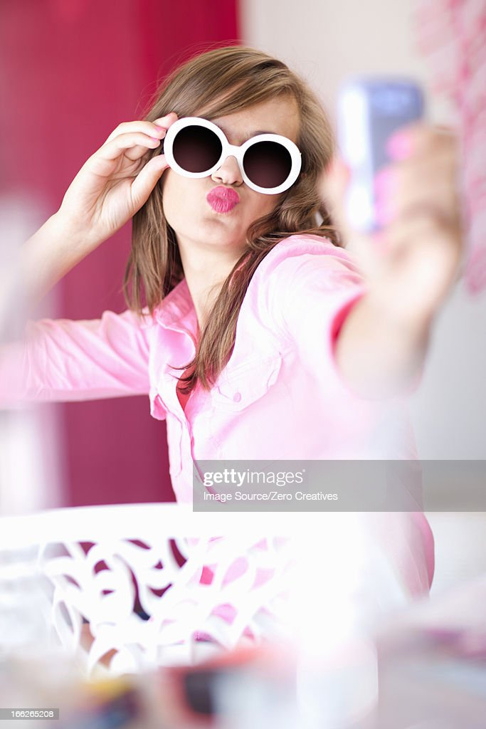 Teenage girl taking picture of herself : Stock Photo
